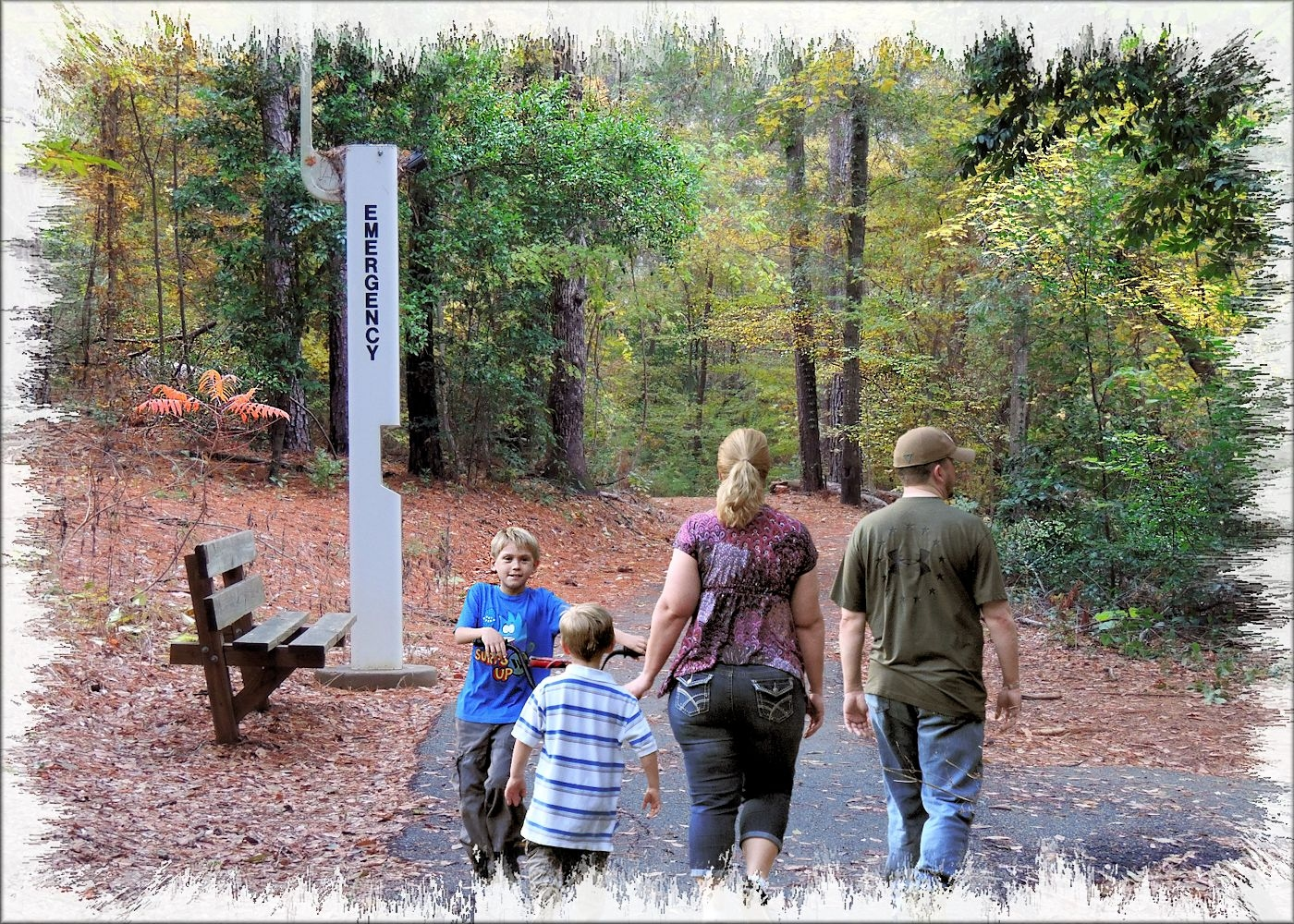 A Family Walking the SFA Recreational Trails in Historic Nacogdoches