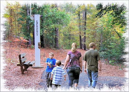 A Family walking on the SFA Recreational Trails